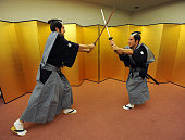 Lukas Podolski and Per Mertesacker of Arsenal FC pose dressed as Samurai Warrior in the Urawa Royal Pines Hotel in Japan for the club's preseason...