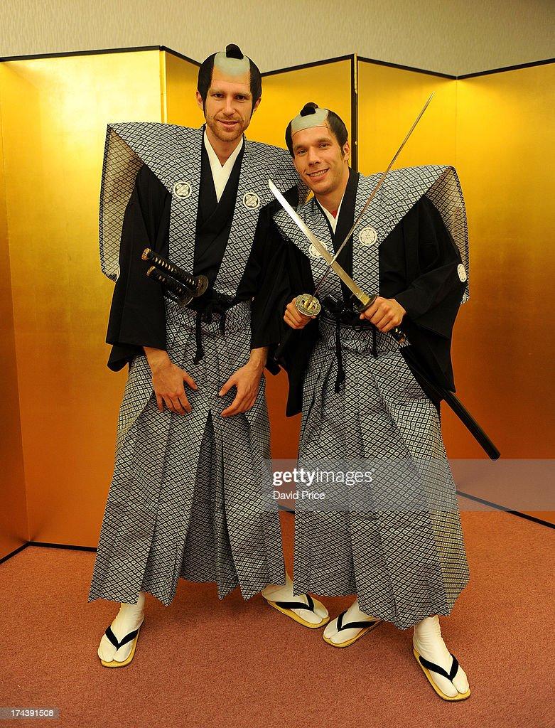 Lukas Podolski (R) and Per Mertesacker of Arsenal FC pose dressed as Samurai Warriors in the Urawa Royal Pines Hotel in Japan for the club's pre-season Asian tour on July 25, 2013 in Saitama, Japan.
