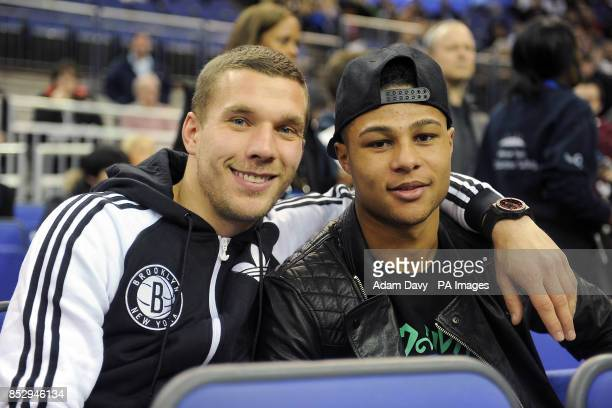 Lukas Podolski and Serge Gnabry during the NBA Global Games London 2014 match at the O2 Arena London