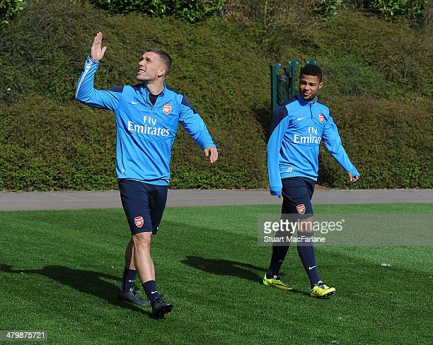 Lukas Podolski and Serge Gnabry of Arsenal before a training session at London Colney on March 21 2014 in St Albans England