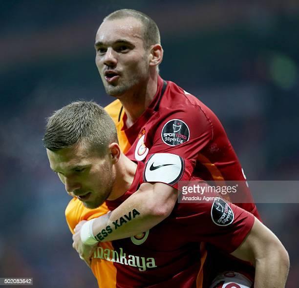 Lukas Podolski and Wesley Sneijder of Galatasaray celebrate scoring during the Turkish Spor Toto Super Lig match between Galatasaray and Akhisar...