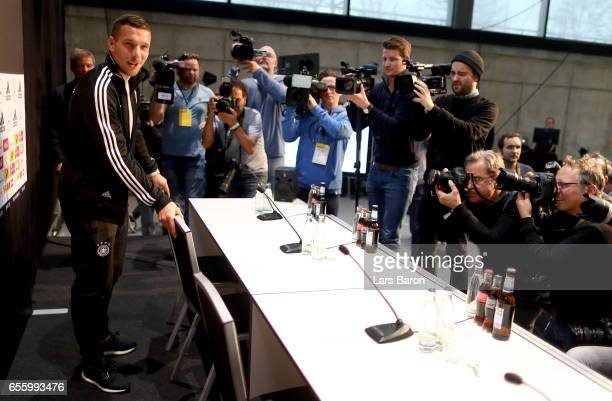Lukas Podolski attends a press conference of the German national team ahead of the international friendly match against England at the Deutsche...