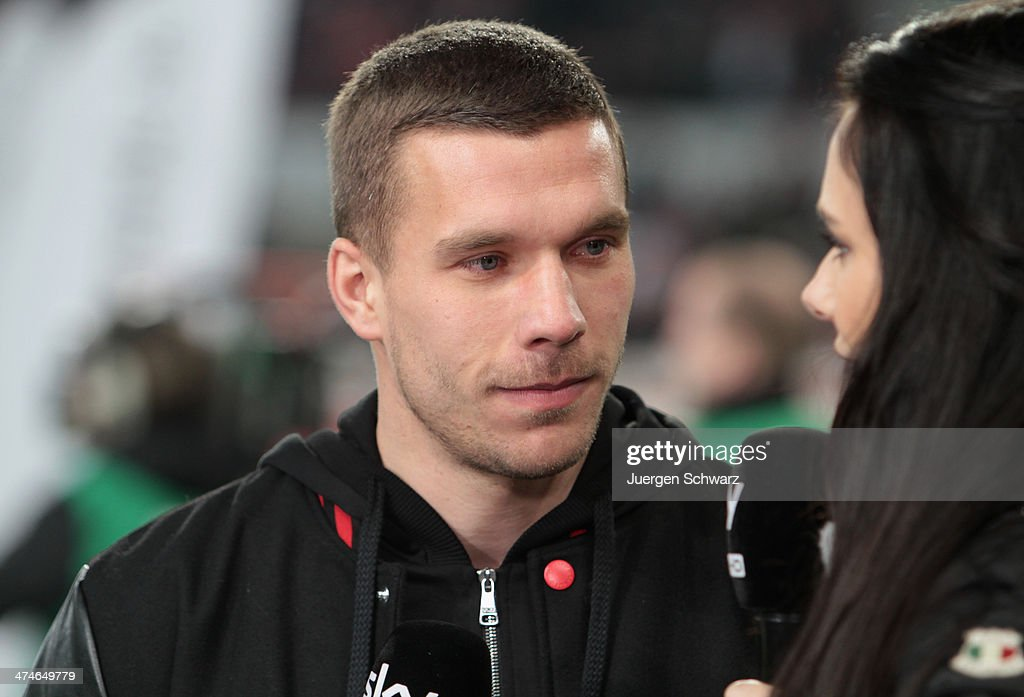 Lukas Podolski gives an interview at the 2nd Bundesliga match between 1. FC Koeln and Greuther Fuerth at RheinEnergieStadion on February 24, 2014 in Cologne, Germany.
