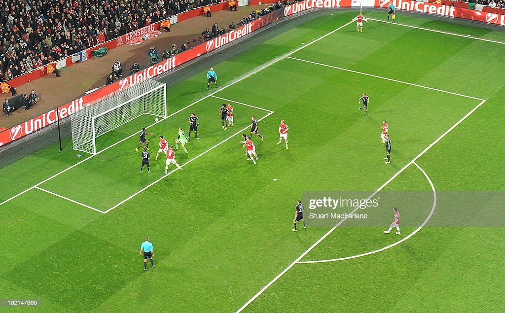 <a gi-track='captionPersonalityLinkClicked' href=/galleries/search?phrase=Lukas+Podolski&family=editorial&specificpeople=204460 ng-click='$event.stopPropagation()'>Lukas Podolski</a> heads past Bayern Munich goalkeeper <a gi-track='captionPersonalityLinkClicked' href=/galleries/search?phrase=Manuel+Neuer&family=editorial&specificpeople=764621 ng-click='$event.stopPropagation()'>Manuel Neuer</a> to score the Arsenal goal during the UEFA Champions League Round of 16 first leg match between Arsenal FC and Bayern Muenchen at Emirates Stadium on February 19, 2013 in London, England.