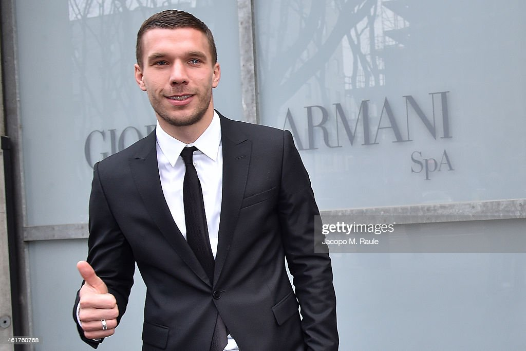 Lukas Podolski is seen leaving the the Emporio Armani Show as a part of Milan Menswear Fashion Week Fall Winter 2015/2016 on January 19, 2015 in Milan, Italy.