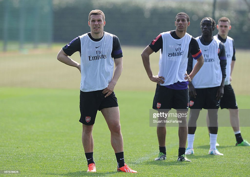 Lukas Podolski, Isaac Hayden and Bacary Sagna of Arsenal during a training session at London Colney on April 26, 2013 in St Albans, England.