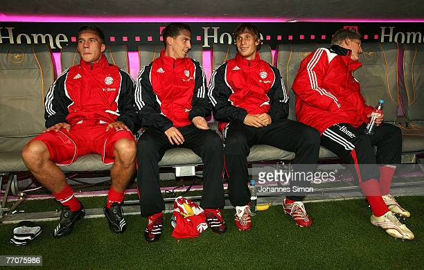 Lukas Podolski Jan Schlaudraff Toni Kroos and Bastian Schweinsteiger sit on the bench prior to the Bundesliga match between Bayern Munich and Cottbus...
