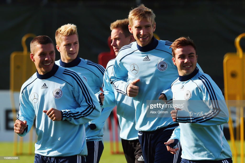 Lukas Podolski, Marco Reus, Marc-Andre ter Stegen, Per Mertesacker and Mario Goetze (L-R) warm up during a Germany training session ahead of their FIFA 2014 World Cup group C qualifying match against Ireland at Commerzbank-Arena on October 10, 2012 in Frankfurt am Main, Germany.