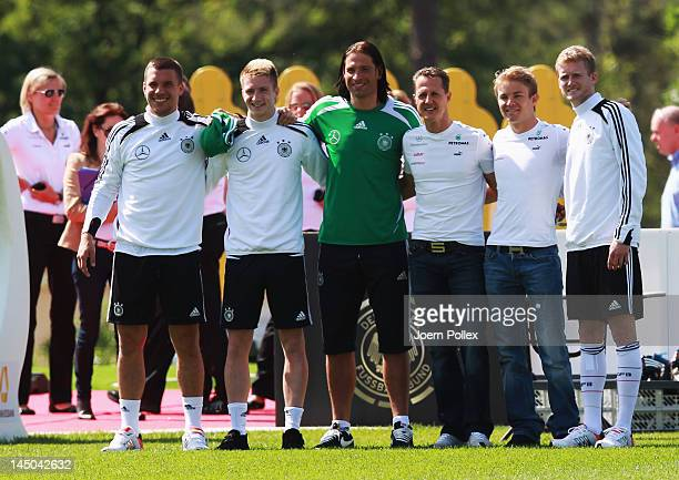 Lukas Podolski Marco Reus Time Wiese Formula 1 driver Michael Schumacher and Nico Rosberg and Andre Schuerrle of Germany pose prior to a Germany...