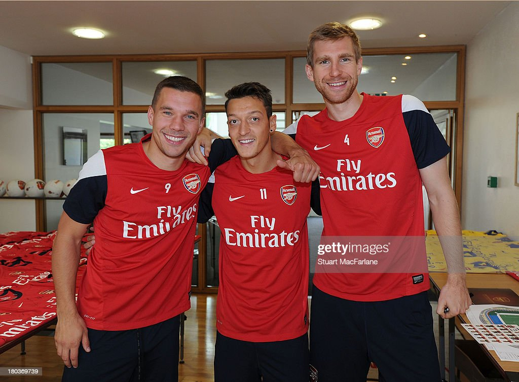 (L-R) Lukas Podolski, Mesut Oezil and Per Mertesacker of Arsenal before a training session at London Colney on September 12, 2013 in St Albans, England.
