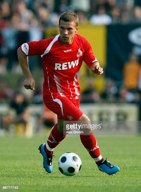 Lukas Podolski of 1FC Koeln in action during a preseason friedly match between 1 FC Koeln and SG Schneifel on July 1 2009 in Stadtkyll Germany