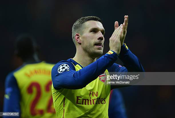 Lukas Podolski of Arsenal applauds the crowd after victory in the UEFA Champions League Group D match between Galatasaray AS and Arsenal FC at Ali...