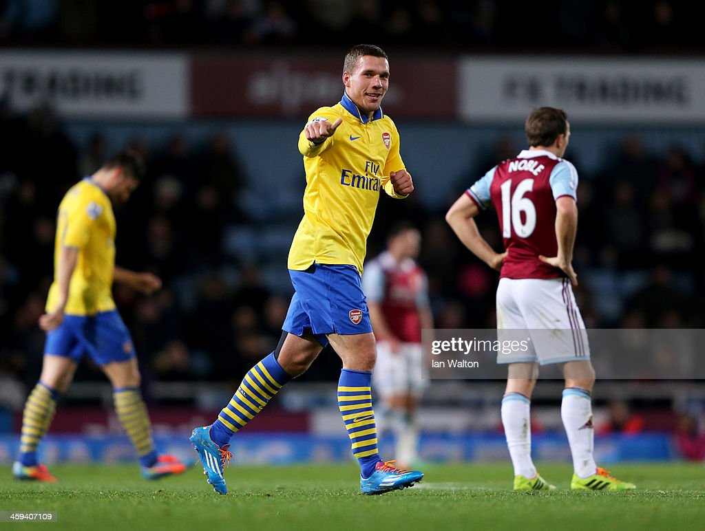 Lukas Podolski of Arsenal celebrates as he scores their third goal during the Barclays Premier League match between West Ham United and Arsenal at Boleyn Ground on December 26, 2013 in London, England.