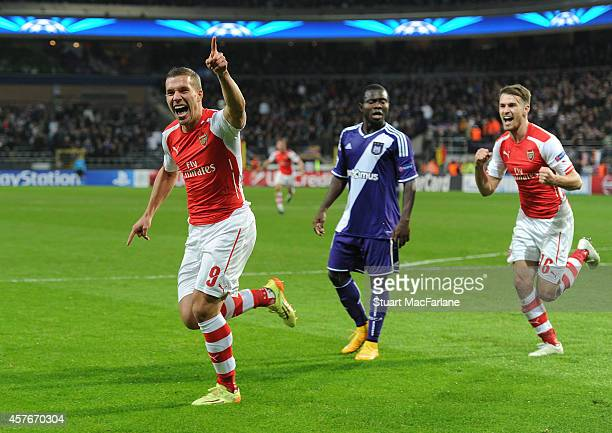 Lukas Podolski of Arsenal celebrates scoring the 2nd Arsenal goal during the UEFA Champions League match between RSC Anderlecht and Arsenal at the...