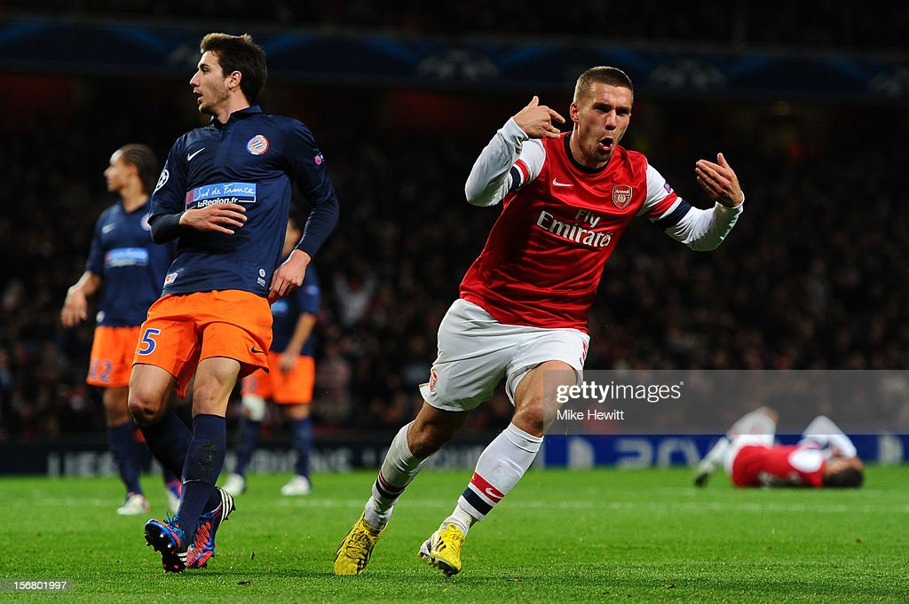 <a gi-track='captionPersonalityLinkClicked' href=/galleries/search?phrase=Lukas+Podolski&family=editorial&specificpeople=204460 ng-click='$event.stopPropagation()'>Lukas Podolski</a> of Arsenal celebrates scoring their second goal during the UEFA Champions League group B match between Arsenal FC and Montpellier Herault SC at Emirates Stadium on November 21, 2012 in London, England.