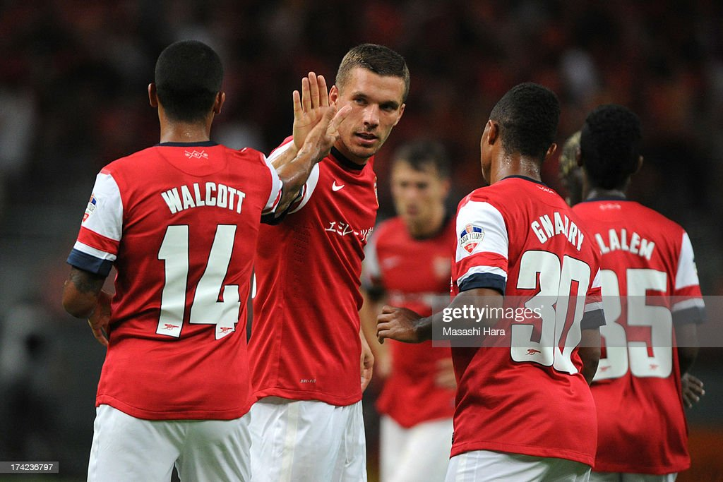 <a gi-track='captionPersonalityLinkClicked' href=/galleries/search?phrase=Lukas+Podolski&family=editorial&specificpeople=204460 ng-click='$event.stopPropagation()'>Lukas Podolski</a> #9 of Arsenal celebrates the third goal by Theo Walcott (L) during the pre-season friendly match between Nagoya Grampus and Arsenal at Toyota Stadium on July 22, 2013 in Toyota, Aichi, Japan.