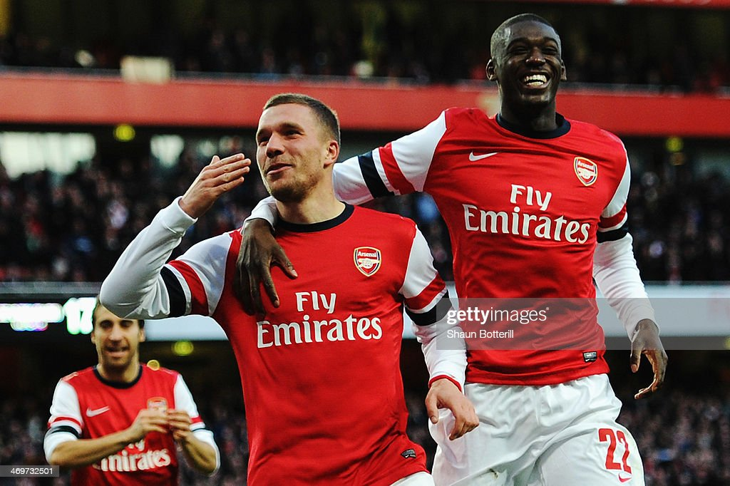 <a gi-track='captionPersonalityLinkClicked' href=/galleries/search?phrase=Lukas+Podolski&family=editorial&specificpeople=204460 ng-click='$event.stopPropagation()'>Lukas Podolski</a> (L) of Arsenal celebrates with team mate <a gi-track='captionPersonalityLinkClicked' href=/galleries/search?phrase=Yaya+Sanogo&family=editorial&specificpeople=5862550 ng-click='$event.stopPropagation()'>Yaya Sanogo</a> after scoring during the FA Cup Fifth Round match between Arsenal and Liverpool at the Emirates Stadium on February 16, 2014 in London, England.