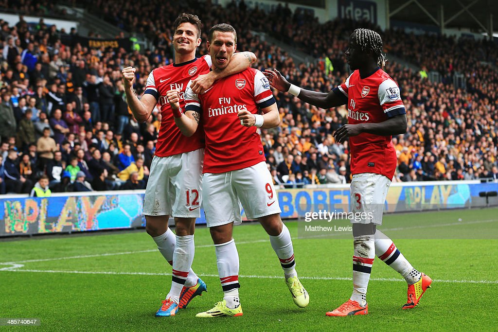 <a gi-track='captionPersonalityLinkClicked' href=/galleries/search?phrase=Lukas+Podolski&family=editorial&specificpeople=204460 ng-click='$event.stopPropagation()'>Lukas Podolski</a> (C) of Arsenal celebrates with team mates <a gi-track='captionPersonalityLinkClicked' href=/galleries/search?phrase=Olivier+Giroud&family=editorial&specificpeople=5678034 ng-click='$event.stopPropagation()'>Olivier Giroud</a> (L) and Bacary Sagna (R) after scoring his sides third goal during the Barclays Premier League match between Hull City and Arsenal at KC Stadium on April 20, 2014 in Hull, England.