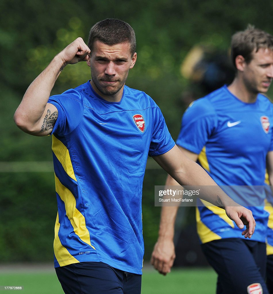 Lukas Podolski of Arsenal during a training session ahead of their UEFA Champions League Play Off second leg match against Fenerbache at London Colney on August 26, 2013 in St Albans, England.