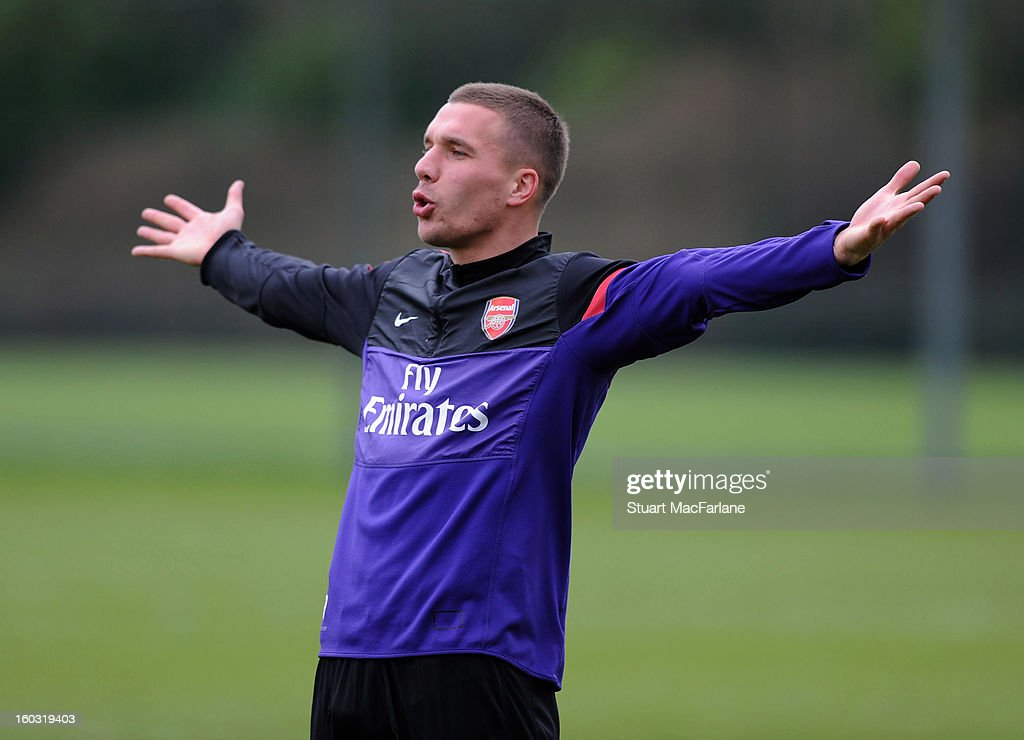 <a gi-track='captionPersonalityLinkClicked' href=/galleries/search?phrase=Lukas+Podolski&family=editorial&specificpeople=204460 ng-click='$event.stopPropagation()'>Lukas Podolski</a> of Arsenal during a training session at London Colney on January 29, 2013 in St Albans, England.