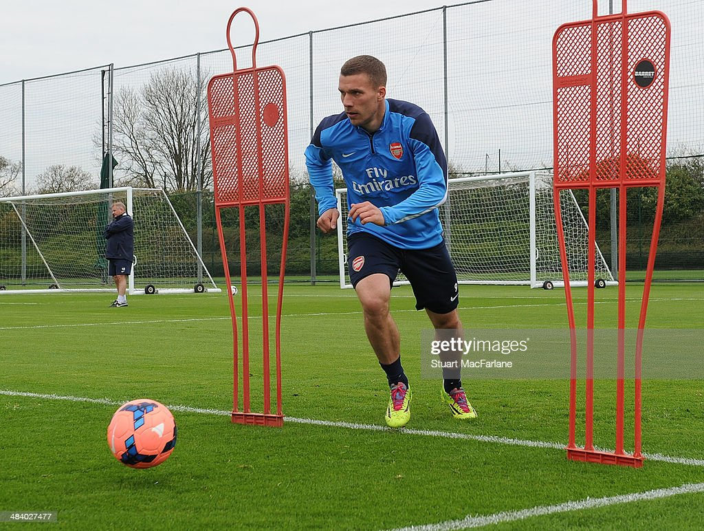 ST. ALBANS, ENGLAND - Lukas Podolski of Arsenal during a training session at London Colney on April 11, 2014 in St Albans, England.