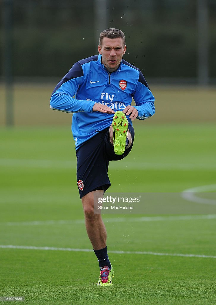 ST. ALBANS, ENGLAND - <a gi-track='captionPersonalityLinkClicked' href=/galleries/search?phrase=Lukas+Podolski&family=editorial&specificpeople=204460 ng-click='$event.stopPropagation()'>Lukas Podolski</a> of Arsenal during a training session at London Colney on April 11, 2014 in St Albans, England.
