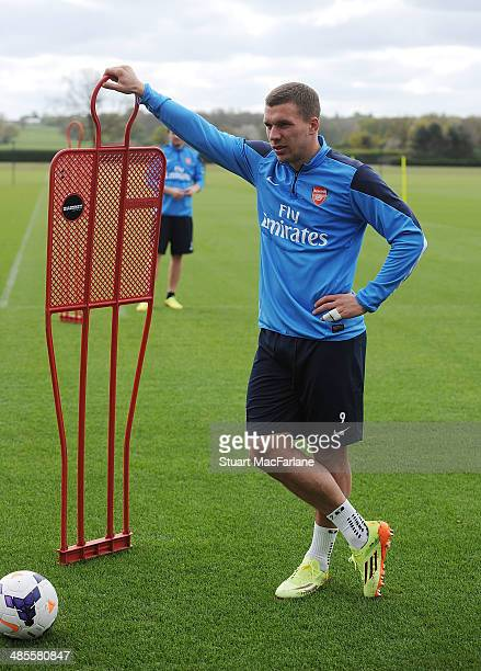 Lukas Podolski of Arsenal during a training session at London Colney on April 19 2014 in St Albans England