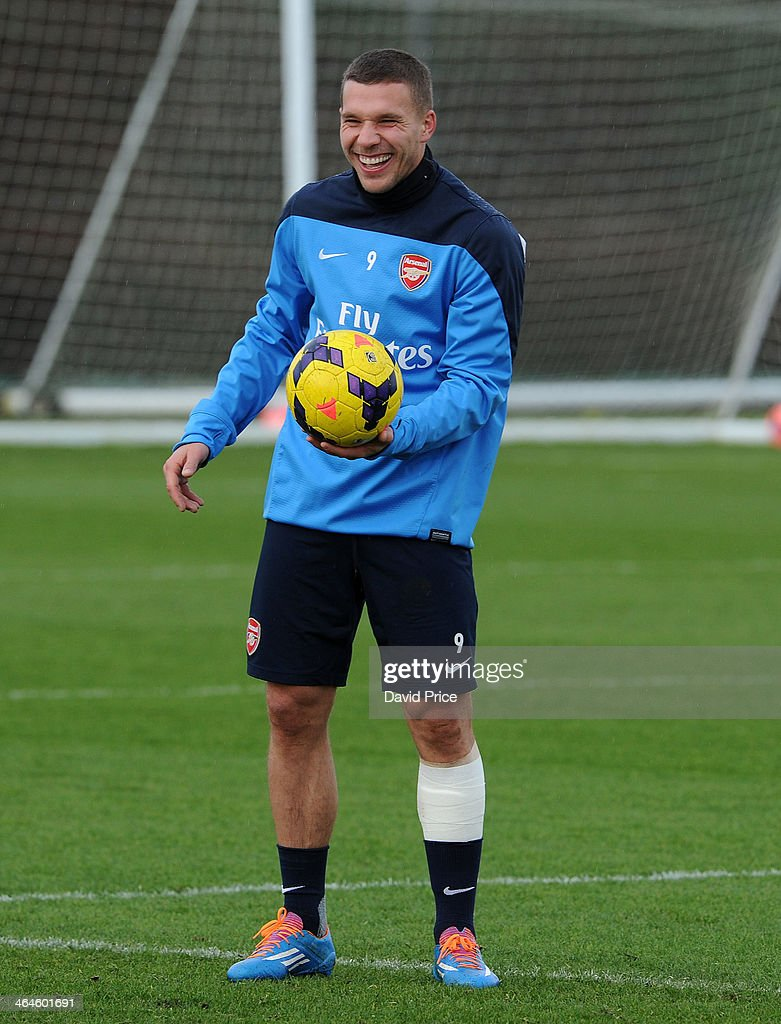 <a gi-track='captionPersonalityLinkClicked' href=/galleries/search?phrase=Lukas+Podolski&family=editorial&specificpeople=204460 ng-click='$event.stopPropagation()'>Lukas Podolski</a> of Arsenal during Arsenal Training Session at London Colney on January 23, 2014 in St Albans, England.