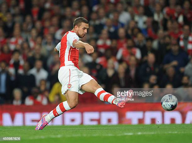 Lukas Podolski of Arsenal during the Capital One Cup 3rd match between Arsenal and Southampton at Emirates Stadium on September 23 2014 in London...