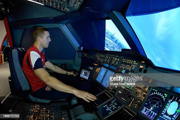 Lukas Podolski of Arsenal in the Emirates' A380 flight simulator on October 31 2013 in Greenwich England