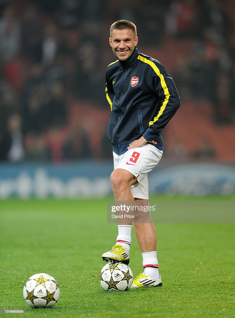 <a gi-track='captionPersonalityLinkClicked' href=/galleries/search?phrase=Lukas+Podolski&family=editorial&specificpeople=204460 ng-click='$event.stopPropagation()'>Lukas Podolski</a> of Arsenal looks on before the UEFA Champions League Group B match between Arsenal FC and FC Schalke 04 at Emirates Stadium on October 24, 2012 in London, England.