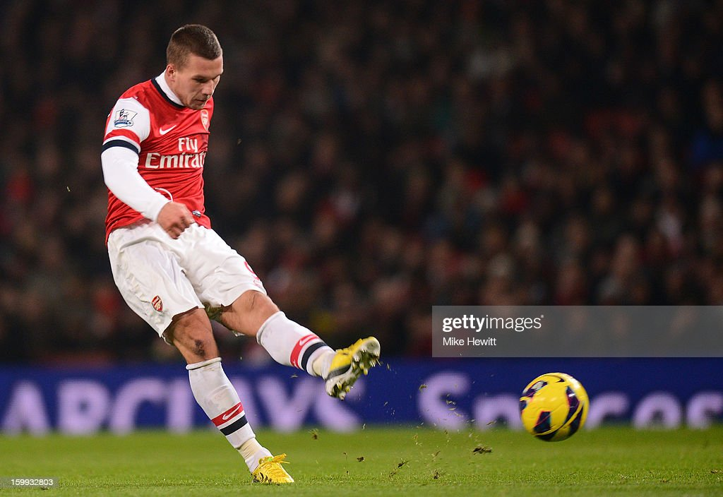 <a gi-track='captionPersonalityLinkClicked' href=/galleries/search?phrase=Lukas+Podolski&family=editorial&specificpeople=204460 ng-click='$event.stopPropagation()'>Lukas Podolski</a> of Arsenal scores their first goal during the Barclays Premier League match between Arsenal and West Ham United at Emirates Stadium on January 23, 2013 in London, England.