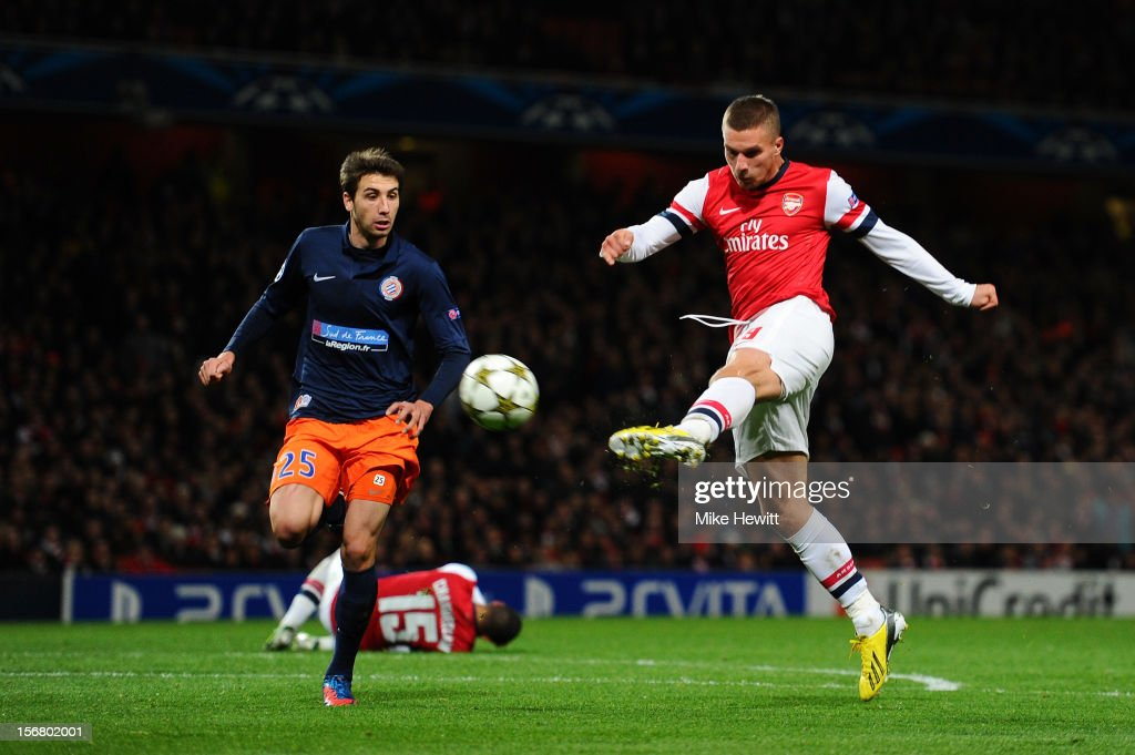 <a gi-track='captionPersonalityLinkClicked' href=/galleries/search?phrase=Lukas+Podolski&family=editorial&specificpeople=204460 ng-click='$event.stopPropagation()'>Lukas Podolski</a> of Arsenal scores their second goal during the UEFA Champions League group B match between Arsenal FC and Montpellier Herault SC at Emirates Stadium on November 21, 2012 in London, England.