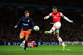 Lukas Podolski of Arsenal scores their second goal during the UEFA Champions League group B match between Arsenal FC and Montpellier Herault SC at...