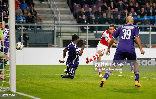 Lukas Podolski of Arsenal scores their second goal during the UEFA Champions League Group D match between RSC Anderlecht and Arsenal at Constant...