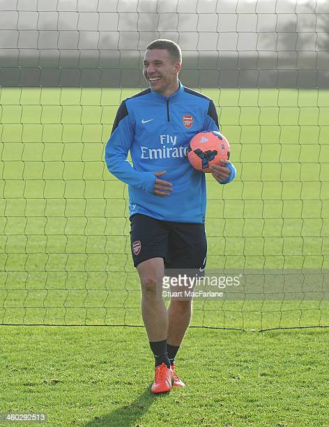 Lukas Podolski of Arsenal takes part in a a training session at London Colney on January 3 2014 in St Albans England