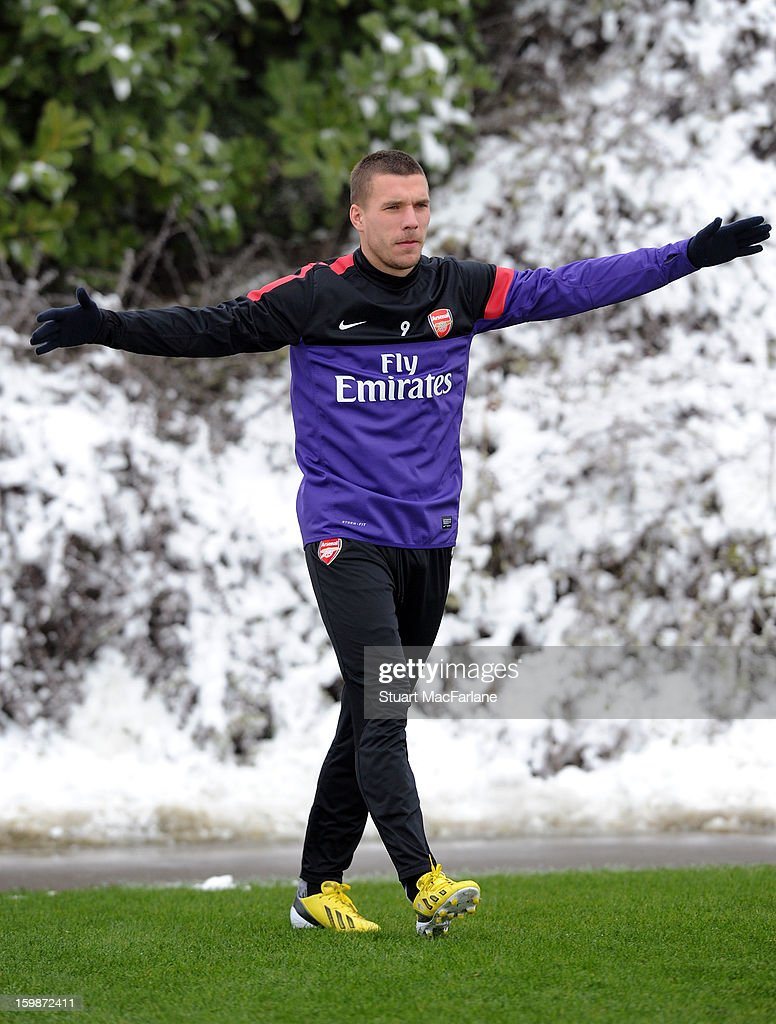 Lukas Podolski of Arsenal takes part in a training session at London Colney on January 22, 2013 in St Albans, England.