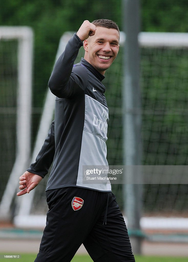 Lukas Podolski of Arsenal takes part in a training session at London Colney on May 18, 2013 in St Albans, England.
