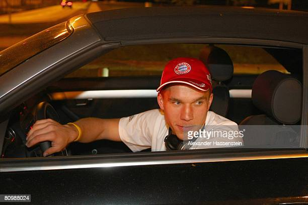 Lukas Podolski of Bayern Munich leaves the parking lot with his car after arriving with his team at the Munich airport on May 4 2008 in Munich...