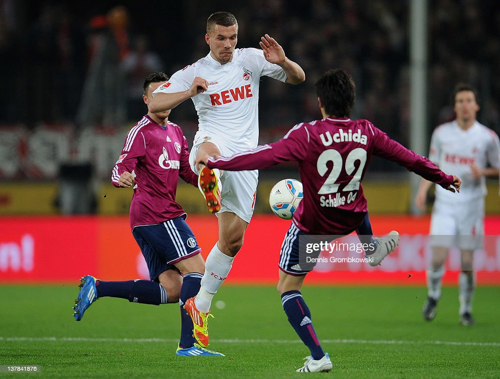 <a gi-track='captionPersonalityLinkClicked' href=/galleries/search?phrase=Lukas+Podolski&family=editorial&specificpeople=204460 ng-click='$event.stopPropagation()'>Lukas Podolski</a> (C) of Cologne challenges <a gi-track='captionPersonalityLinkClicked' href=/galleries/search?phrase=Atsuto+Uchida&family=editorial&specificpeople=4318608 ng-click='$event.stopPropagation()'>Atsuto Uchida</a> of Schalk during the Bundesliga match between 1. FC Koeln and FC Schalke 04 at RheinEnergieStadion on January 28, 2012 in Cologne, Germany.