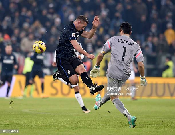 Lukas Podolski of FC Internazionale and Gianluigi Buffon of Juventus during the Serie A match between Juventus FC and FC Internazionale Milano at...