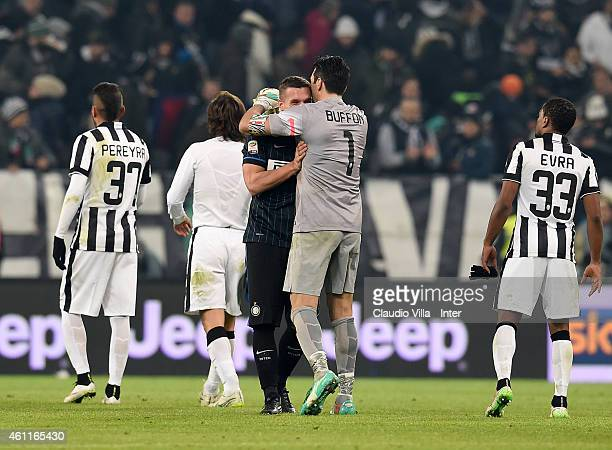 Lukas Podolski of FC Internazionale and Gianluigi Buffon of Juventus at the end of Serie A match between Juventus FC and FC Internazionale Milano at...