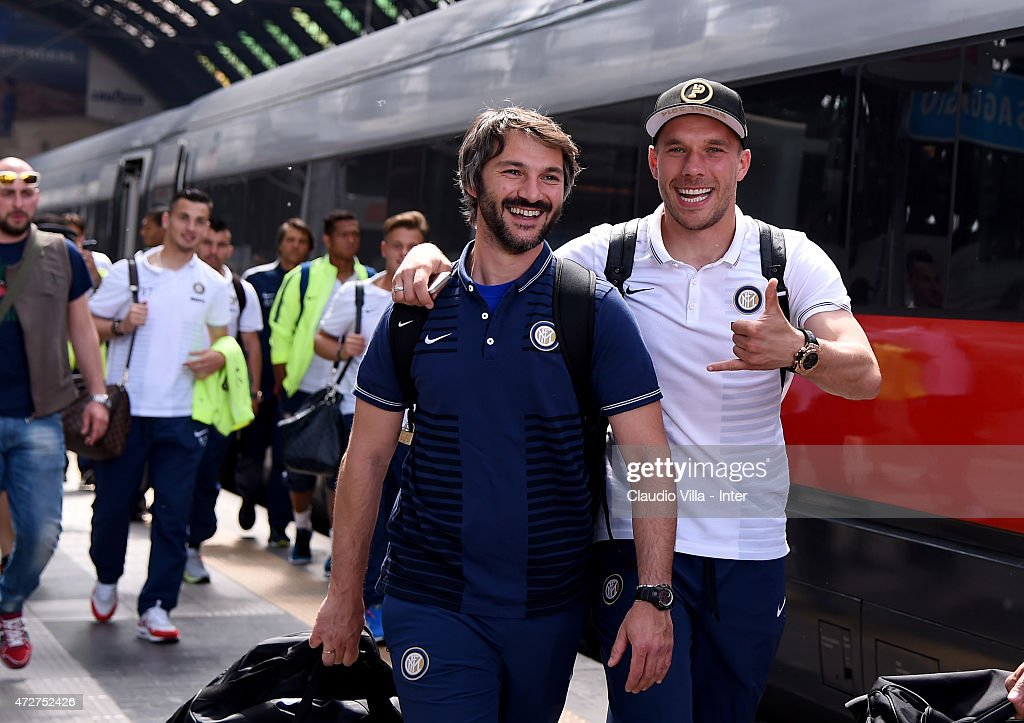 Lukas Podolski of FC Internazionale (R) departs to Rome at train station on May 9, 2015 in Milano, Italy.
