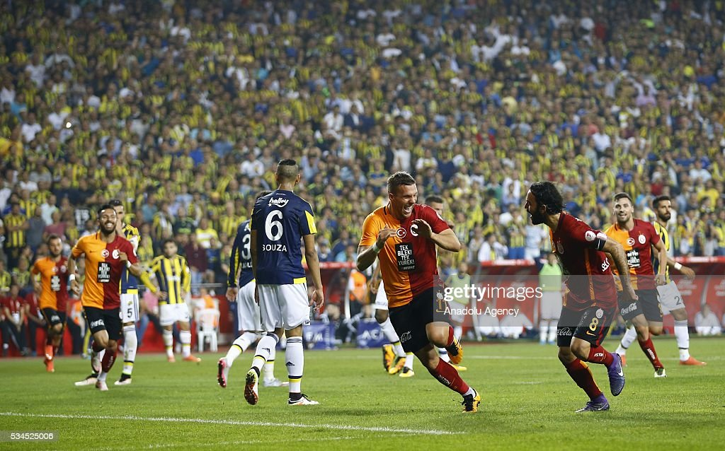 Lukas Podolski (C) of Galatasaray celebrates with his teammate Selcuk Inan (right) after scoring a goal during the Ziraat Turkish Cup Final match between Galatasaray and Fenerbahce at Antalya Ataturk Stadium in Antalya, Turkey on May 26, 2016.