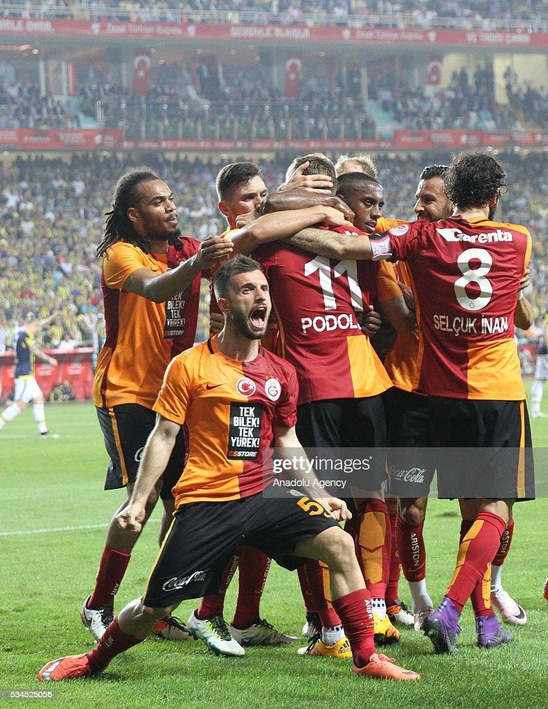 Lukas Podolski (11) of Galatasaray celebrates with his teammates after scoring a goal during the Ziraat Turkish Cup Final match between Galatasaray and Fenerbahce at Antalya Ataturk Stadium in Antalya, Turkey on May 26, 2016.