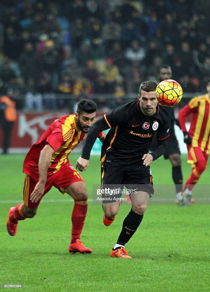 Lukas Podolski of Galatasaray in action against Mustafa Akbas of Kayserispor during Turkish Spor Toto Super Lig football match between Kayserispor...