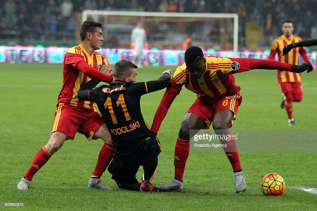 Lukas Podolski of Galatasaray in action against Omer Bayram and Larrys Mabiala of Kayserispor during Turkish Spor Toto Super Lig football match...