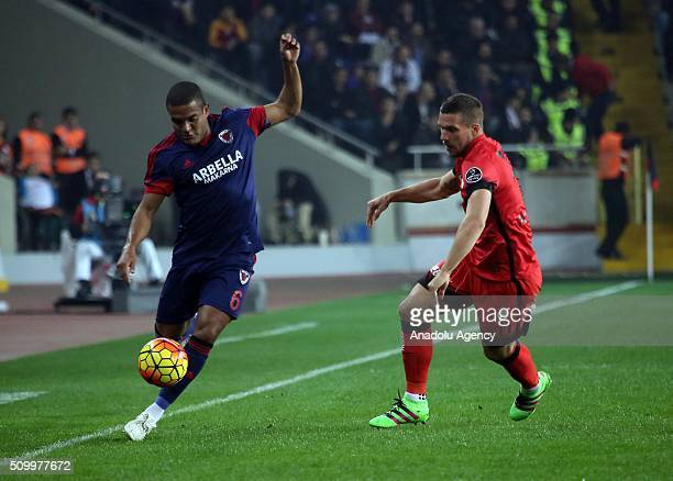 Lukas Podolski of Galatasaray in action against Vederson of Mersin Idmanyurdu during the Turkish Spor Toto Super Lig football match between Mersin...