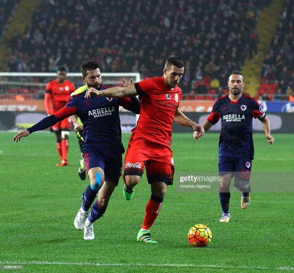 Lukas Podolski of Galatasaray (C) in action during the Turkish Spor Toto Super Lig football match between Mersin Idmanyurdu and Galatasaray at Mersin Stadium in Mersin, Turkey on February 13, 2016.