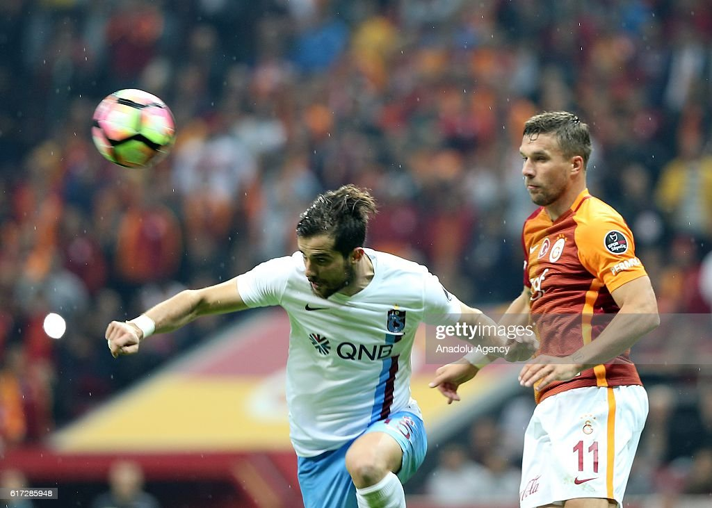Lukas Podolski (R) of Galatasaray in action during Turkish Spor Toto Super Lig match between Galatasaray and Trabzonspor at Turk Telekom Arena Stadium in Istanbul, Turkey on October 22, 2016.